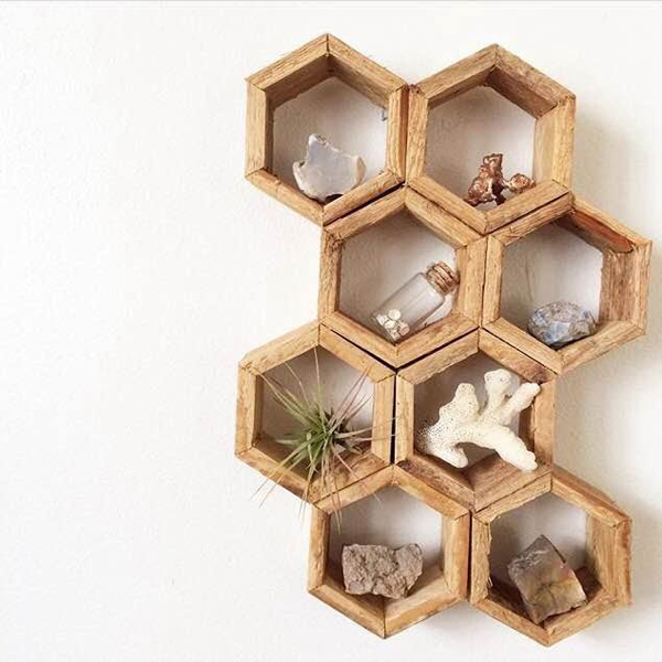 """Made from old cedar wood someone tore out of a home on my street, these honeycomb shelves are perfect for any rock collector, airplant enthusiast, or just someone with a knack for knick-knacks. Each individual hexagon is 2.75"""" in diameter."""